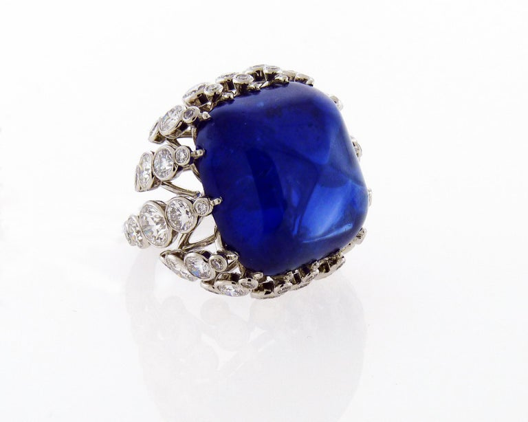 A fabulous cocktail ring embellished with a cushion sugar-loaf cut sapphire weighing 43.22 carats. The sapphire is accompanied by two certificates from AGL and GRS laboratories stating that the sapphire is of Ceylon origin with the indication of
