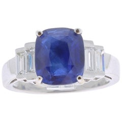 4.35 Carat Ceylon Sapphire Ring set Baguette Diamonds 18 Karat White Gold Ring
