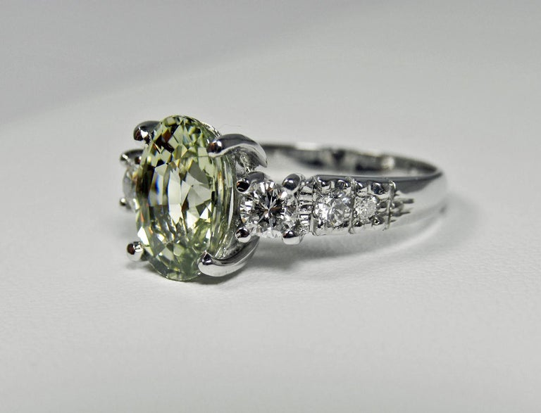 EGL USA Certified 4.38cts Natural Untreated Fine Sapphire and Diamond Engagement Wedding Ring 18k White Gold Primary Stones: Natural Sapphire Shape or Cut : Oval Faceted Cut Average Color/Clarity : Fine Light Yellowish-Green / VVS Total Sapphire
