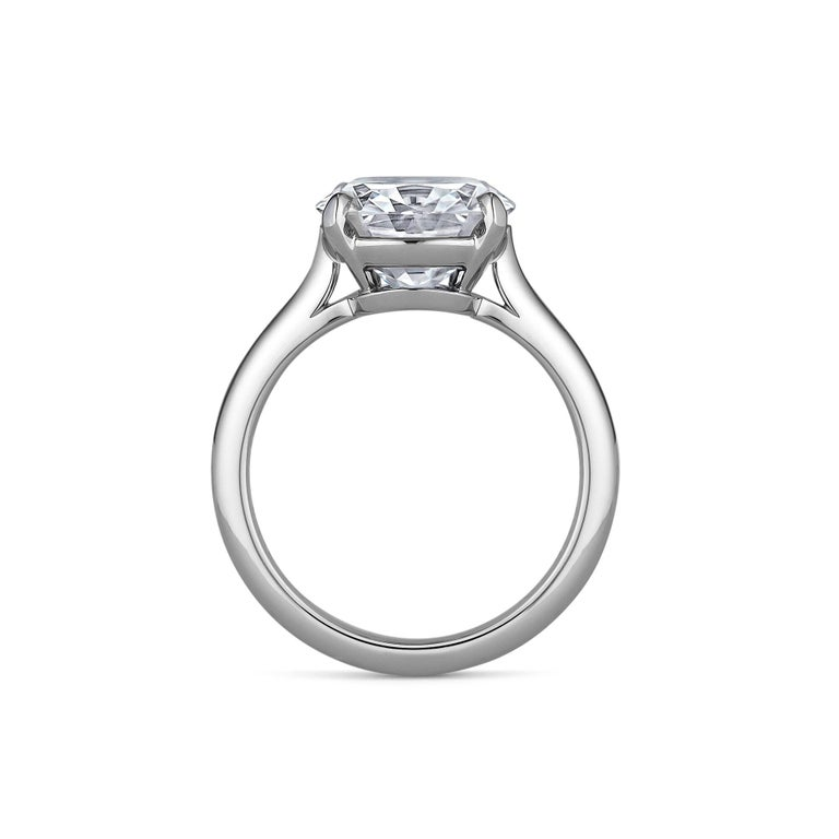 A diamond is still a woman's best friend, and this extraordinary cushion brilliant cut engagement ring symbolizes that eternal spiritual connection.  Weighing 4.68 carats, this strikingly full-bodied and seductive cushion brilliant cut diamond