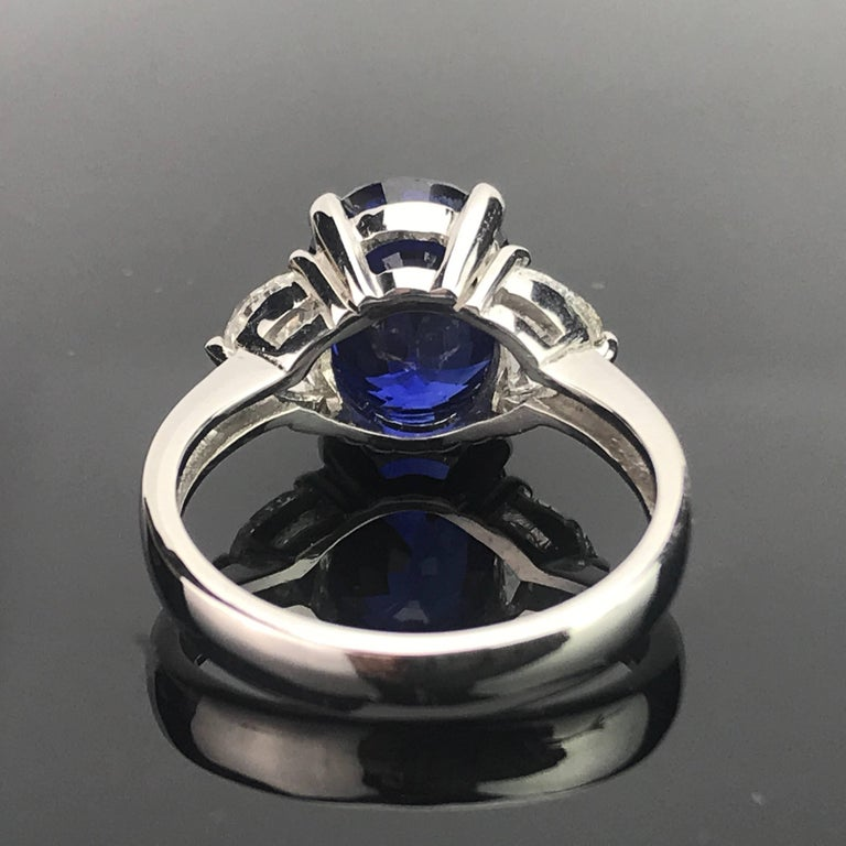 Art Deco Certified 5.06 Carat Vivid Blue Sapphire and Diamond Three-Stone Ring For Sale