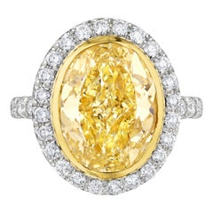 Certified 5.12 Carat Fancy Yellow Oval Diamond Engagement Ring in Platinum