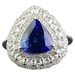 Certified 5.30 Carat Pear Shape Blue Sapphire and Diamond Engagement Ring