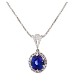 Certified 6.30 Carat Oval Tanzanite and Diamond Necklace in 18 Carat White Gold