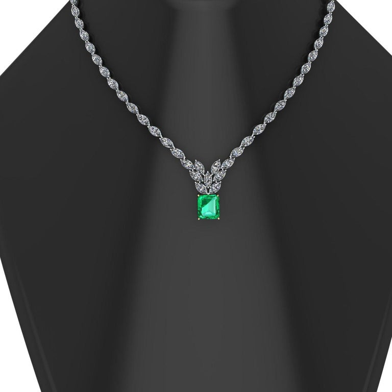 A unique necklaces showcasing approximately 23 carats of natural white Diamonds Marquise cut, G/F color, VS clarity, eye clean, with a center gemstone 6.31 carat GRS Certified Colombian Emerald, made in 18k yellow gold in the center setting and