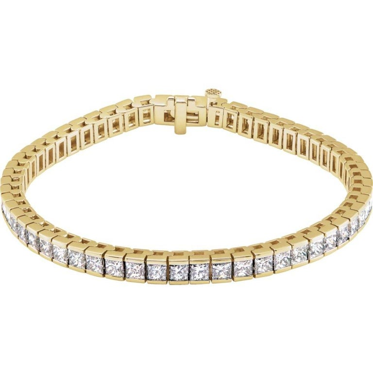 Deco 7.04 Carat Princess cut Diamond Channel-set Tennis Bracelet in 14K Yellow Gold. Certified by IGI Lab in New York, with full diamond jewelry grading report.  7.04 Carats of Princess Cut SI1-SI2 Diamonds,  and 14.00 grams of 14K Yellow Gold.
