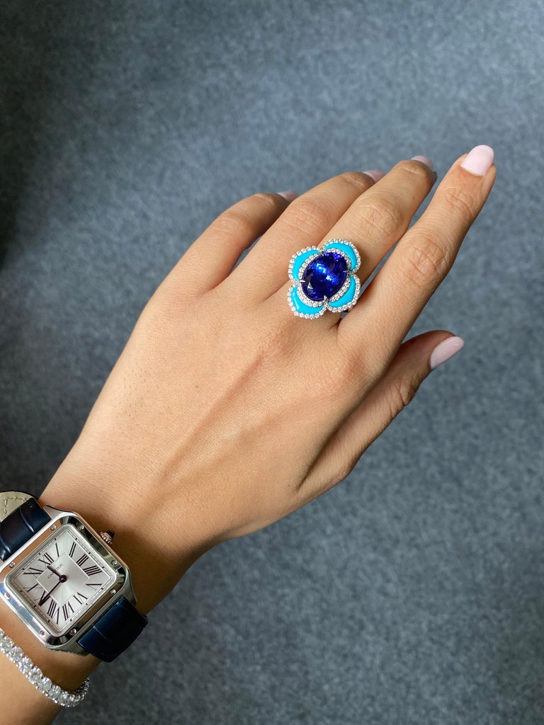 A very unique, one of a kind 8.16 carat Tanzanite, Turquoise and 0.7 carat VS quality White Diamond cocktail ring. The tanzanite is completely transparent, with no inclusions and great luster.  Currently sized at US 7, can be altered.  Free shipping