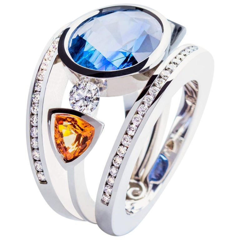 Certified 9.45 Carat Intense Blue Sapphire 2 Orange Corunds and 56 Diamonds Ring For Sale