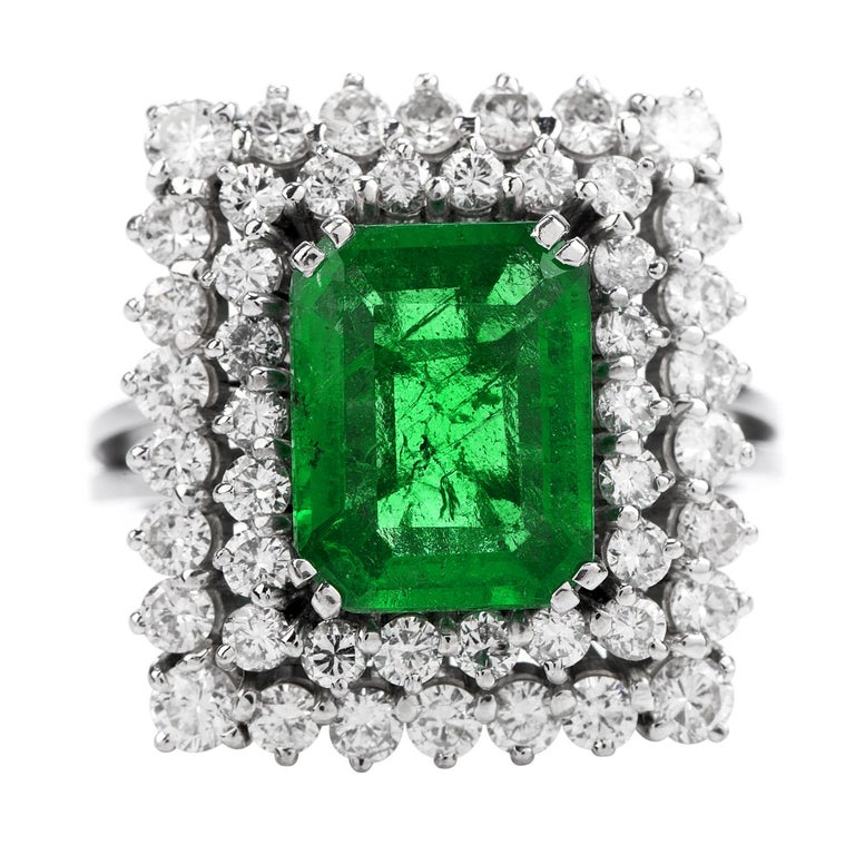 This Art Deco Inspired Design, Rectangular Shaped Cocktail Ring,  has the perfect balance between sparkle and Deep color!  It is crafted in solid Platinum.  With an AGL Certified Colombian Emerald of 2.48 carats in the center,   with No treatments