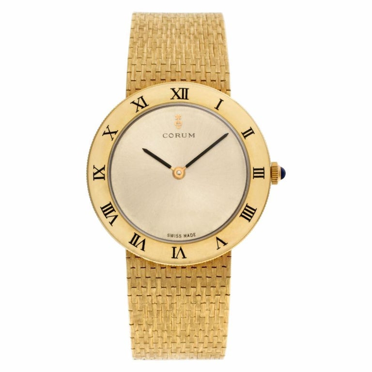 Corum Classic Reference #:57104-100593. Corum Classic in 18k on a woven band. Manual. Ref 57104-100593. Circa 1980s. 7.5