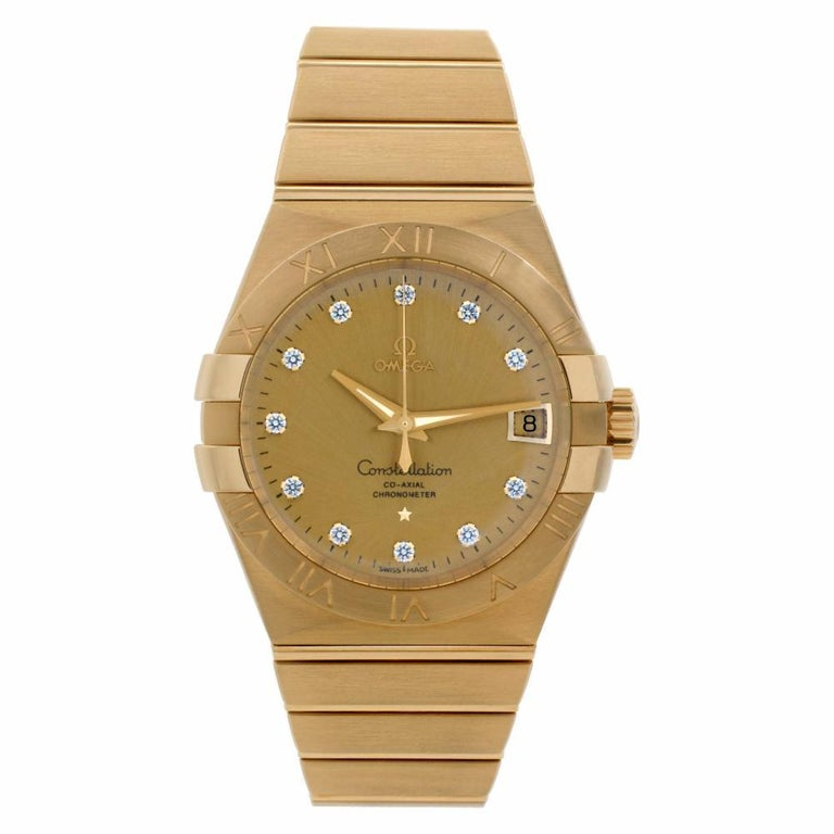 Omega Constellation Reference #:123.50.38.21.58.001. Like New! Omega Constellation in 18k yellow gold, factory diamond dial. Auto movement under glass w/ sweep seconds and date. Complete with box and paper with majority of factory warranty