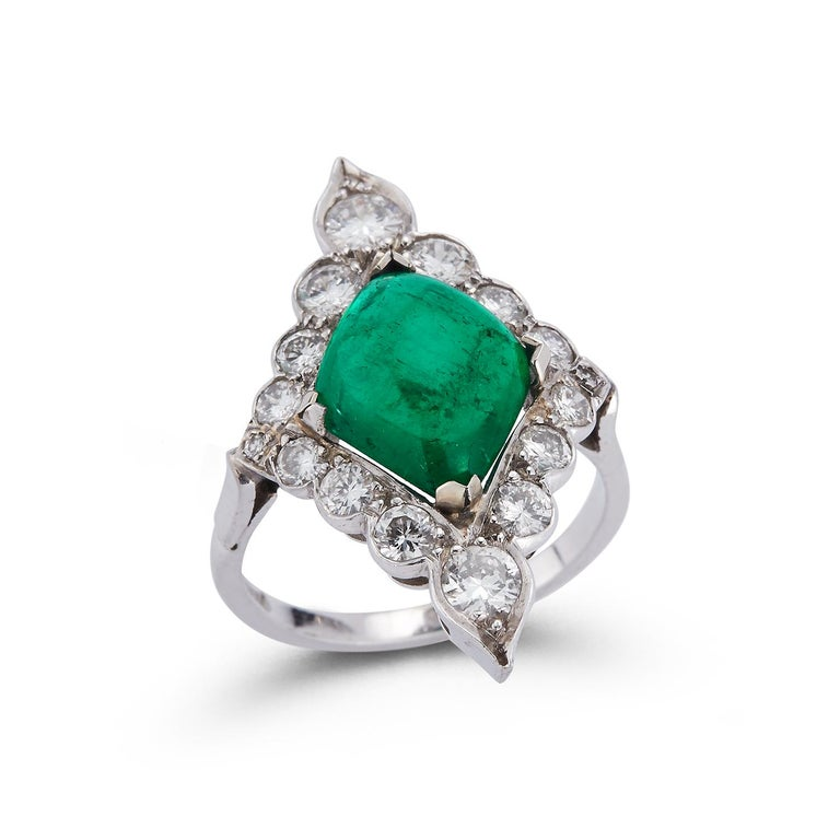 Certified Cabochon Emerald & Diamond Cocktail Navette Ring Approximate Emerald Weight: 3.64 Cts certified by AGL laboratory as Colombian Origin Approximate Diamond Weight: 1.40 Cts  Ring Size: 4.75 Resizable to any size free of charge  Gold Type: