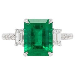 Certified Colombian Emerald and White Diamond in 18 Karat Gold Three-Stone Ring