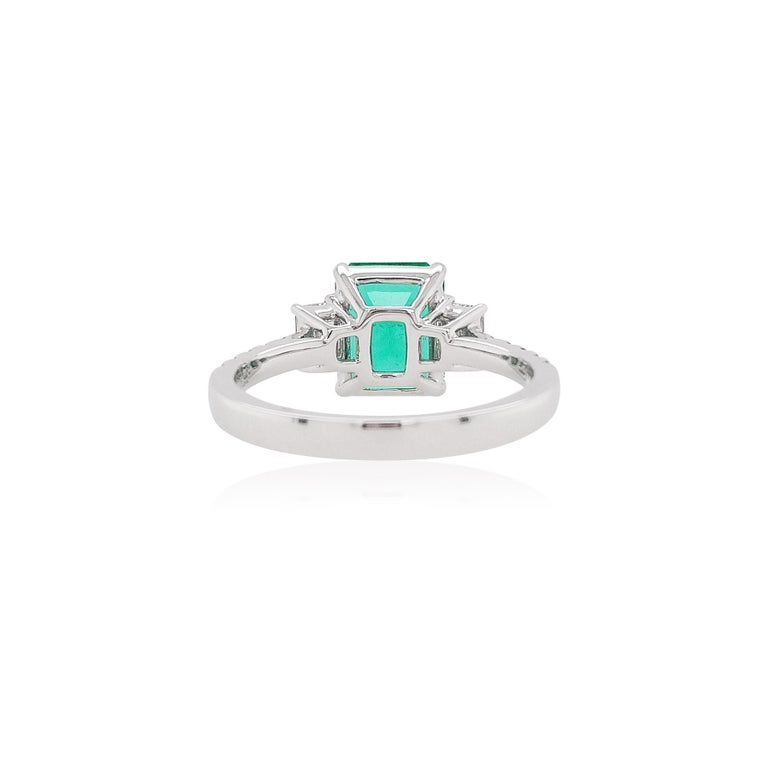 This delicate Platinum ring features a lustrous Colombian Emerald at the forefront of its design. The spectacular hues of the Emerald are perfectly accentuated by the Platinum setting and elegant Emerald-Cut Diamonds shoulders. A versatile piece,