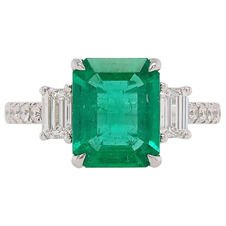 Certified Colombian Emerald and White Diamond in Platinum Three-Stone Ring For Sale