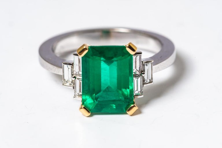Discover Emerald 2.68 Karat Certified White Diamonds and on Yellow and White Gold Engagement Ring Emerald Shaped Emerald 2.68 carat  White Baguette Diamonds 0.68 carat White and Yellow Gold 18 Karat / weight Gold 5.50 gr French size 52.5 US size 6