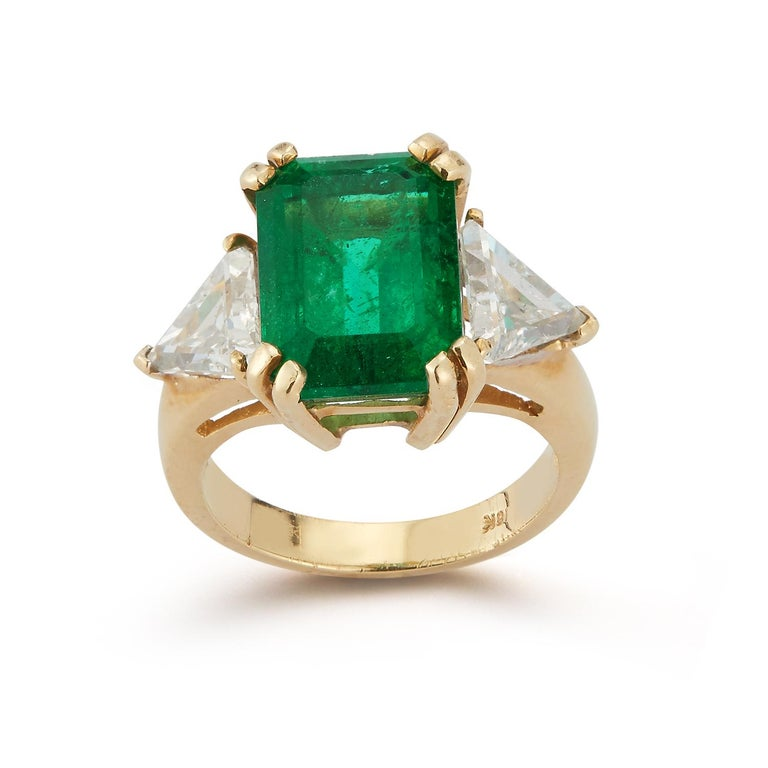 Certified Emerald & Diamond Gold Three Stone Ring set in 18k Yellow Gold Emerald Weight: 7.48 Cts Diamond Weight: 1.93 Cts Ring Size: 6.25 Re-sizable free of charge