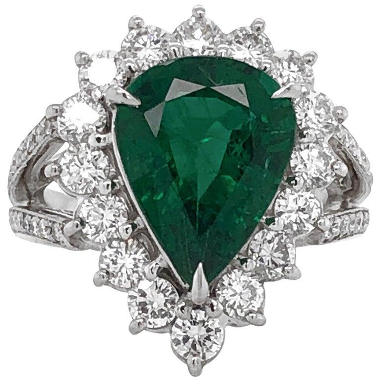 Certified Emerald Pear Cut 3.66 Carat Diamonds Platinum Ring For Sale