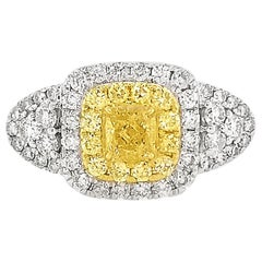 Certified Fancy Intense Yellow Diamond and White Diamond in Platinum Bridal Ring