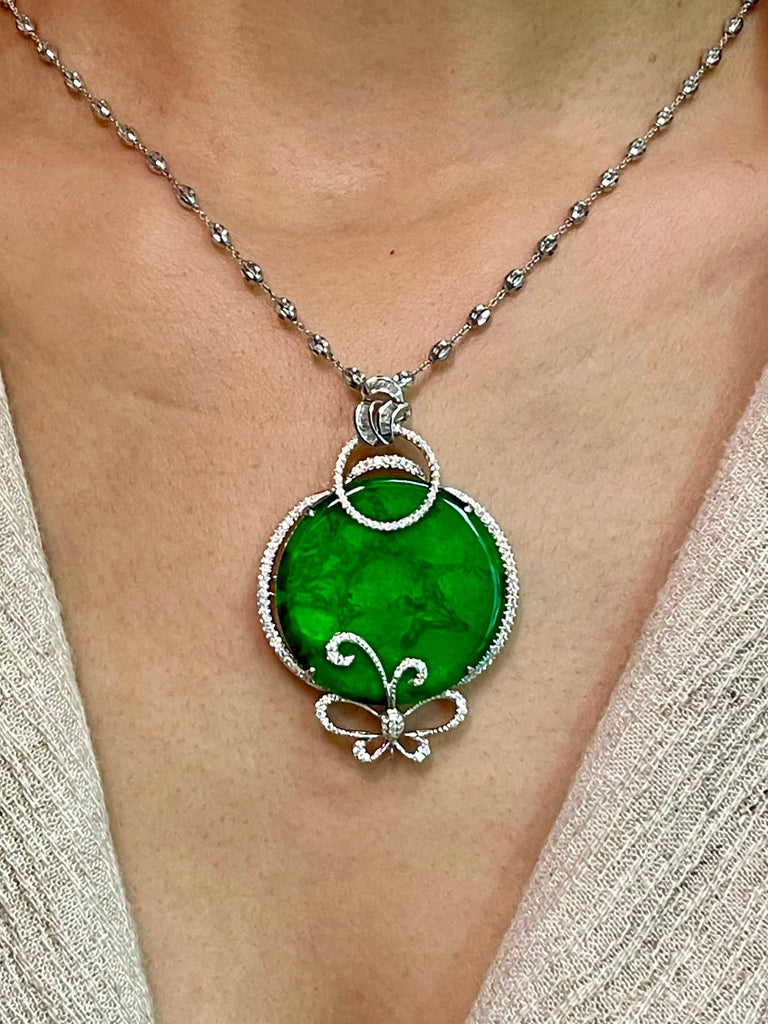 Please check out the HD video! This is a collector's item! This certified natural jadeite jade has no treatment and un-enhanced. The pendant is set in 18k white gold and diamonds with a diamond butterfly motif. There are 0.71 cts of white diamonds