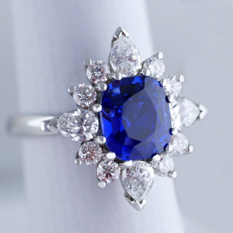 Vintage ring with a fine and lively natural untreated blue sapphire, handmade in England, circa 1960.  Central transparent blue sapphire, rectangular cushion cut, weighing 3.75ct (Carat), certified, natural untreated colour.   The sapphire