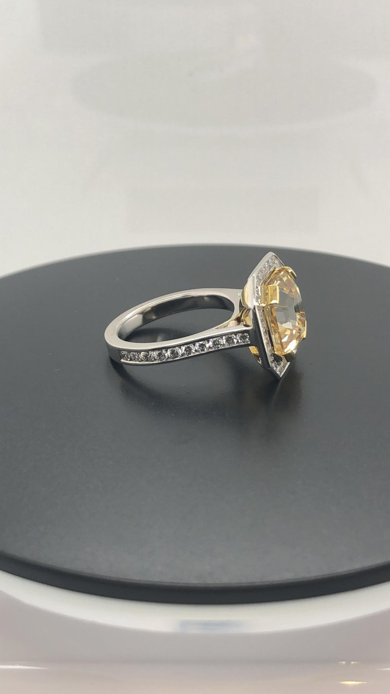 Hand Crafted, 18 Carat Yellow and White Gold Dress Ring, Set with a Certified, Natural, Asscher Cut Yellow Sapphire as per as per C. Dunaigre report # in Yellow Gold End claws, Surrounded by 20 Round Brilliant Cut diamonds, Weighing 0.40 Carats,