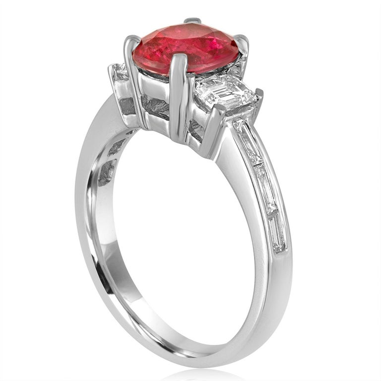 Beautiful Three-Stone Ring The ring is 18K White Gold There are 0.82 Carats in diamonds F/G VS/SI The center is an Oval Red Ruby 2.01 Carats NO HEAT. The Ruby is certified by LAPIS. The ring is a size 6.5, sizable. The ring weighs 5.8 grams