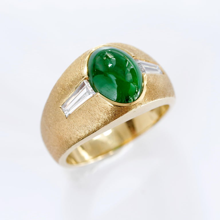 This 18k greenish-gold hand-crafted Mid-Century ring features a certified natural and untreated, highly-polished, medium-dark green Burmese omphacite jade cabochon that represents jade's most prized color. Two sleek, white and clean (H-I, VS2)