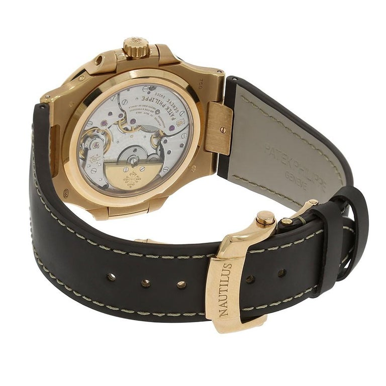 Patek Philippe Nautilus Reference #:5712R. 40mm 18K rose gold case, sapphire crystal back, screw-down crown, black-brown dial with gold applied hour markers with luminescent coating, self-winding caliber 240 PS IRM C LU movement with power reserve,