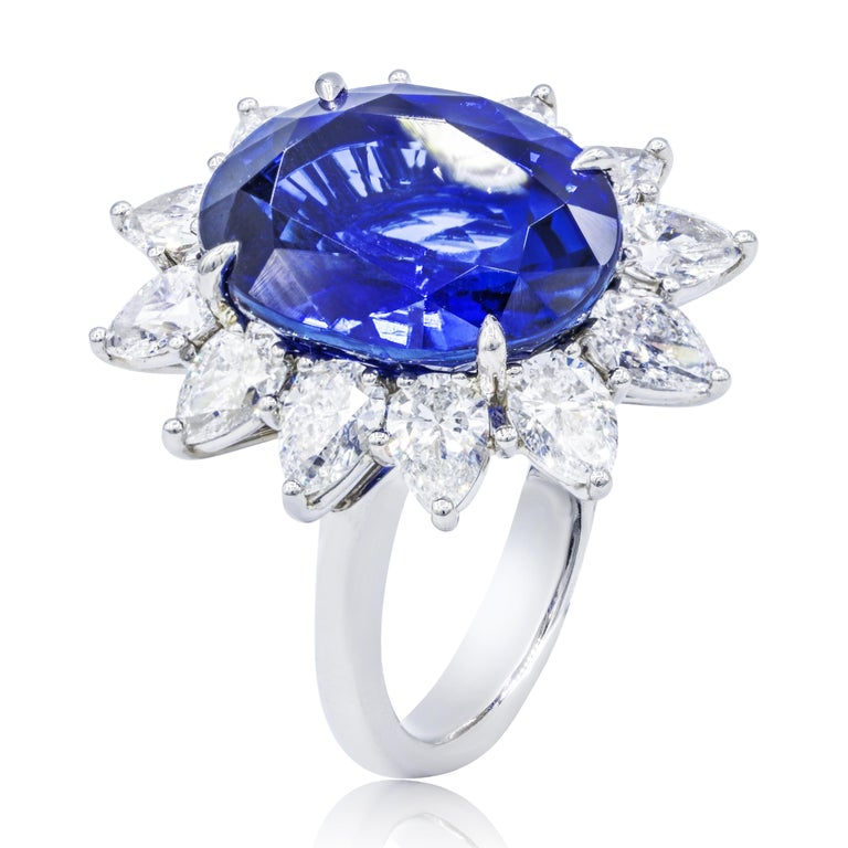 Royal platinum sapphire and diamond ring with C.Dunaigre certified 16.20 carats oval cut ceylon sapphire set with 3.92 carats in a halo with pear shaped diamonds.