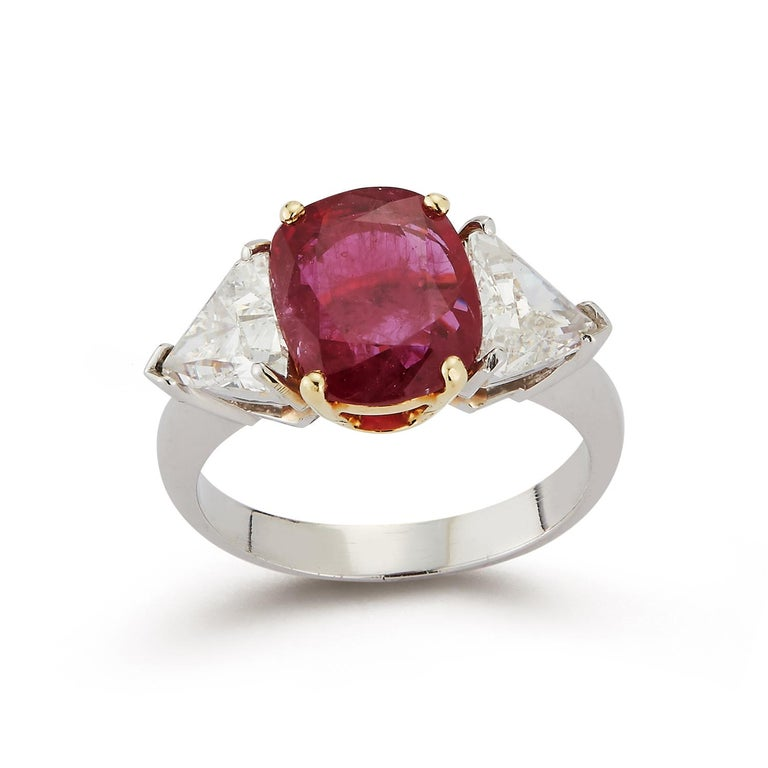 Certified Ruby & Diamond Three Stone Ring Set in Platinum and 18K Yellow Gold Ruby Weight: 2.51 Cts Diamond Weight: 1.59 Cts Ring Size: 5.75  Re-sizable free of Charge