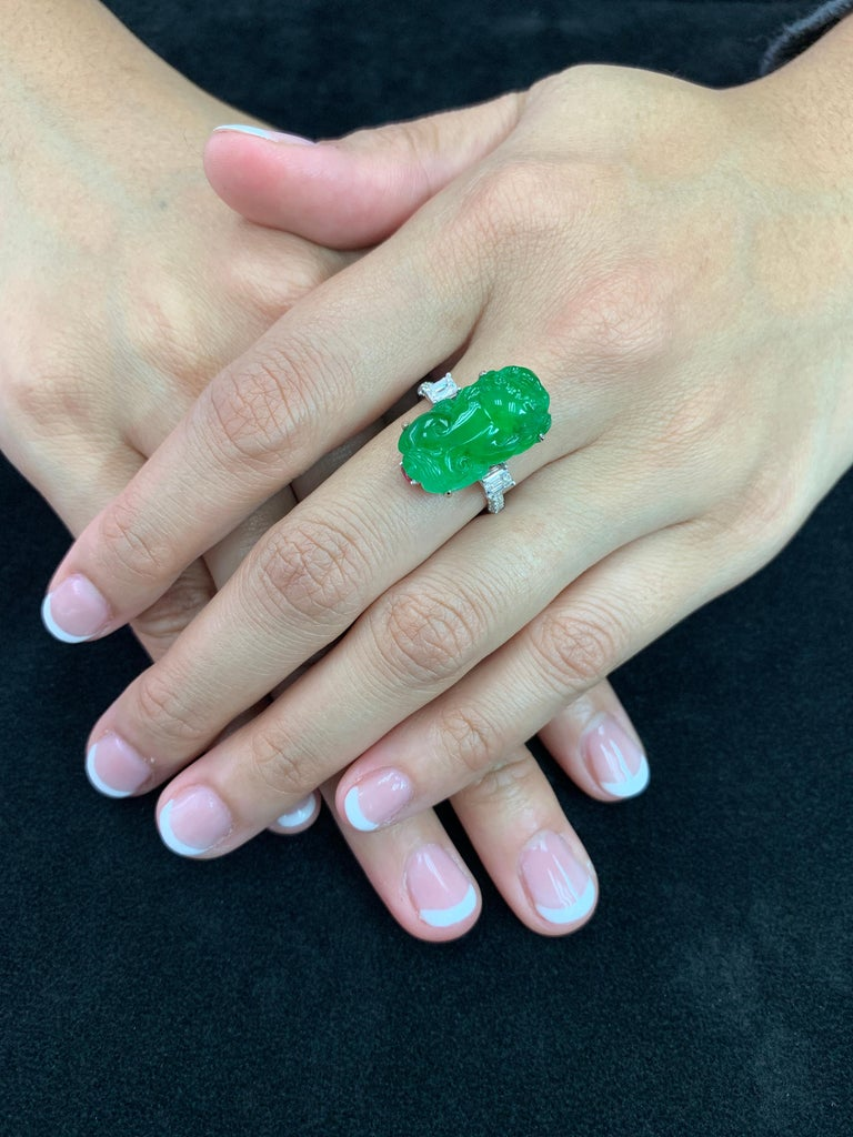 Here is a super vivid green Jade, Spinel and diamond ring. It is certified. The Jade ring is set in 18k white gold, Spinel and diamonds. There are two emerald cut diamonds on each side of the jade totaling 0.78Cts and also small diamonds on the