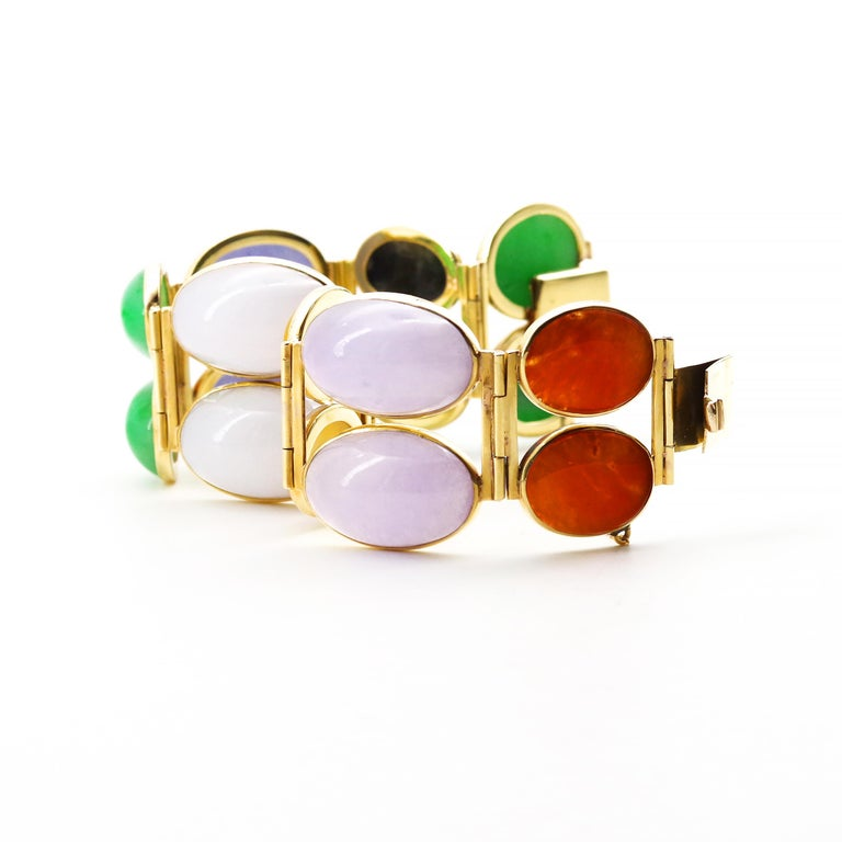 This colorful, classy one-of-a-kind bauble was hand-crafted in 14k yellow gold and features sixteen (16!) Mason-Kay Certified natural and untreated cabochons in three sizes (approximately): 20.17 mm x 13.36 mm, 18.80 mm x 10 mm, 15 mm x 10.25 all of