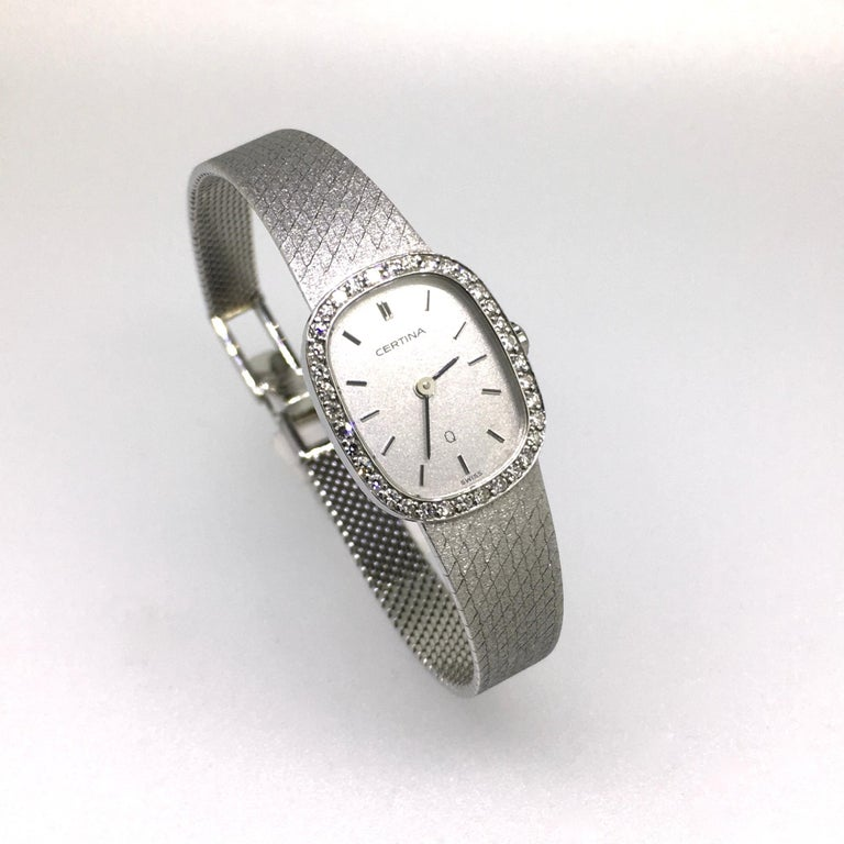 Watch, 18 carat White Gold, set with 36 round cut Diamonds, Certina, Vintage, 1983. Close to Oval shaped case, 18 carat white gold case and bracelet. 18 carat hallmarks. The first collection with very slim Swiss Quartz movement. This watch in