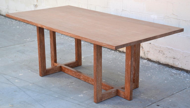 This custom dining table is made from solid, rift-sawn white oak with a