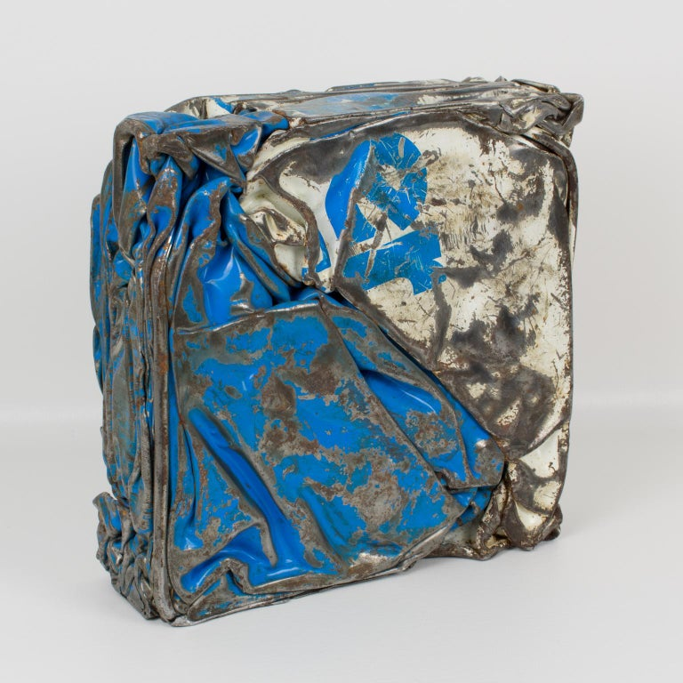Stunning French abstract sculpture, featuring a compression of industrial metal elements. Eye-catching design with original paint in blue and white colors with raw metal detailing. Each face offers a versatile view of the artist's work. French