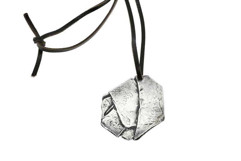 A fine and rare compression pendant by Cesar Baldaccini. Done in his signature style of compressing various metals, this particular piece is rare as it's been done in solid sterling silver. 