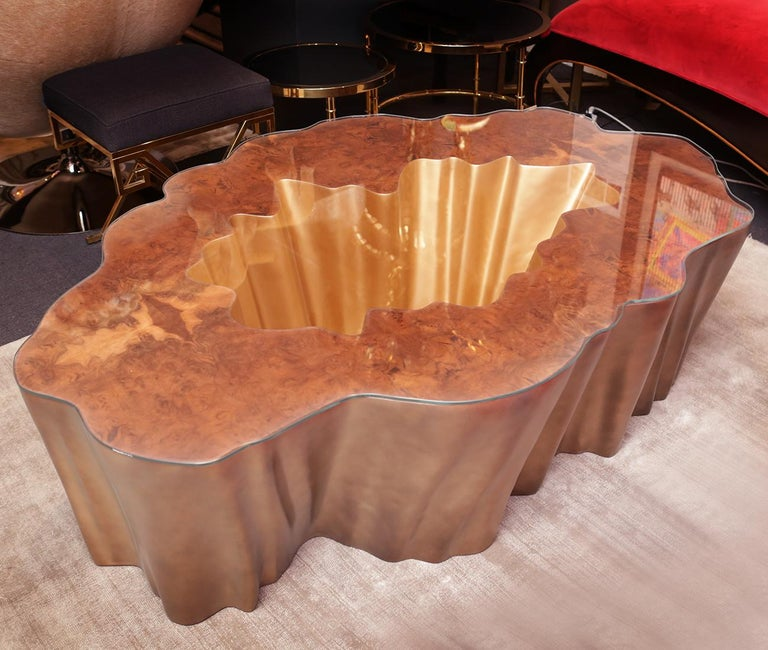 Coffee table Cesar gold with fiber glass base in gold matte finish and with top in walnut wood. With carved clear glass top.