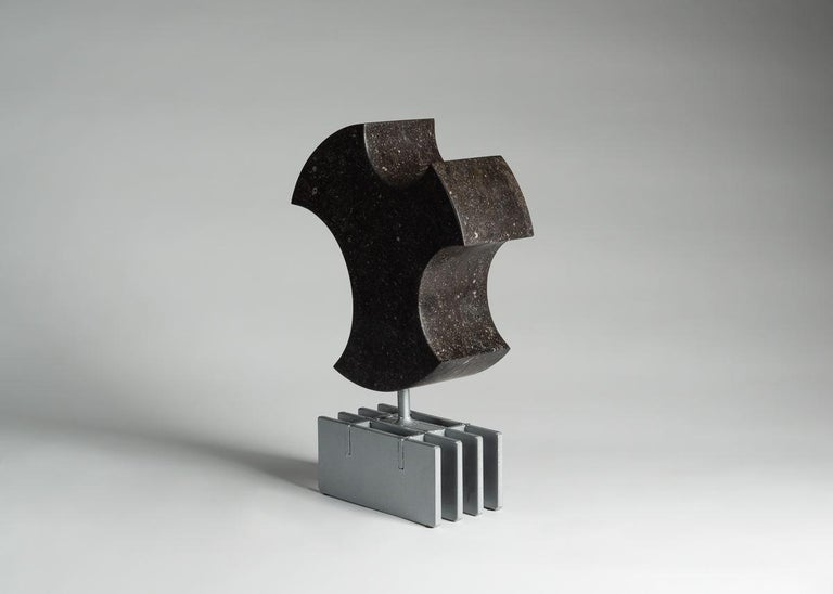 With this captivating blue Belgian stone sculpture, Cesare Arduini has continued his masterful exploration of space, his play of the balance between positive and negative space.