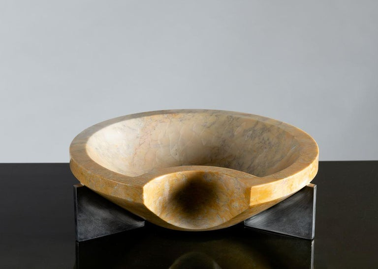 In setting his beautifully cut and polished fountain of Calcutta marble atop a base of sleek stainless steel, master stoneworker Cesare Arduini challenges his audience to compare the elegance of man-made materials with those of nature.  Unique