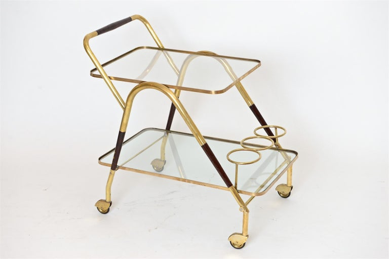 Nice example of Cesare Lacca bar trolley in wood and brass, Italy, circa 1950.