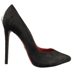 CESARE PACIOTTI pumps come in black suede with a pointed toe and silver tone swo