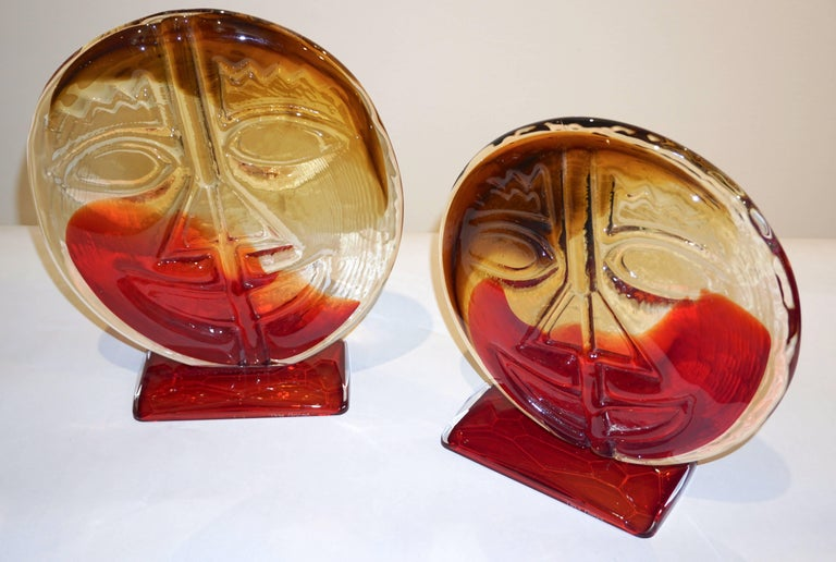 These fun Picasso style Italian decorative faces in Murano Art glass present high quality of Design and execution, the crystal clear Murano glass is worked with bursts of red and yellow, amber colors, the front decorated with an abstract cubist