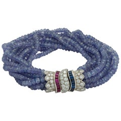 Ceylon Blue Sapphire, Diamond and Ruby Faceted Bead Bracelet in 18 Karat Gold