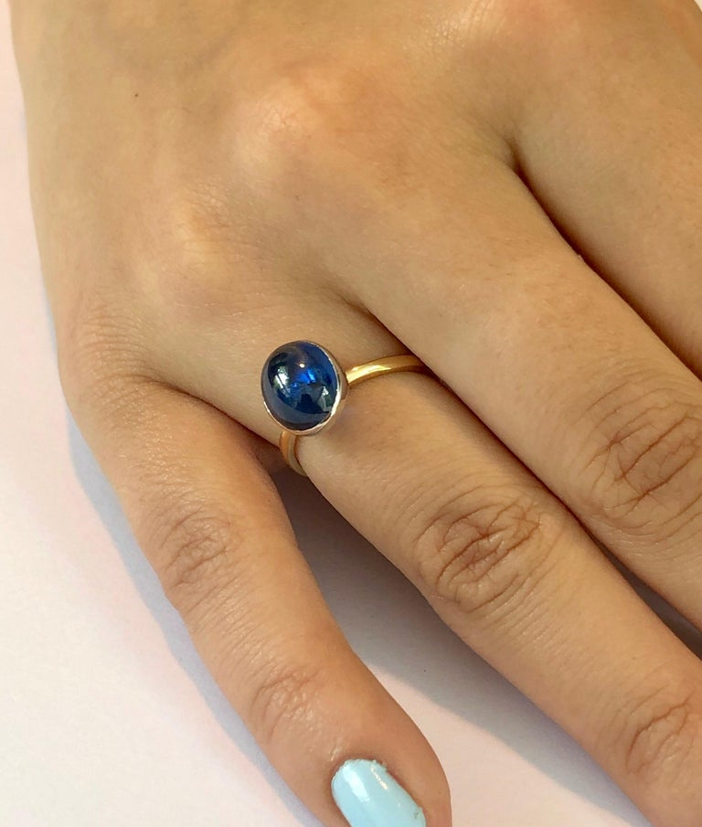 Oval Cut Ceylon Cabochon Sapphire 18 Karat White and Yellow Gold Fashion Ring For Sale