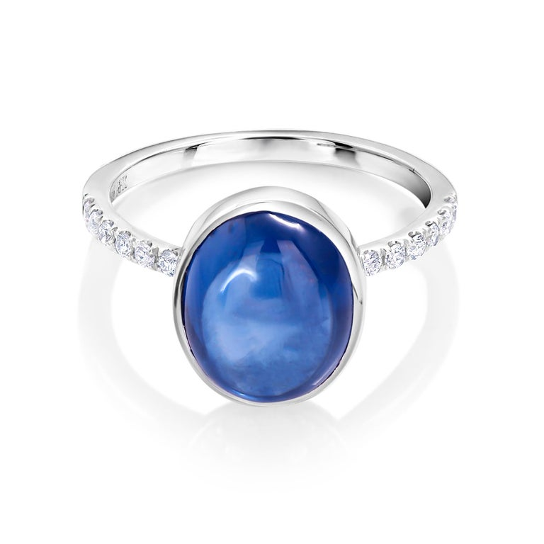 Eighteen karat white gold ring Ceylon cabochon sapphire weighing 4.75 carat      Round diamonds weighting 0.25 carat                                                                   Ring size 6 In Stock Ring can be resized  New Ring Handmade in