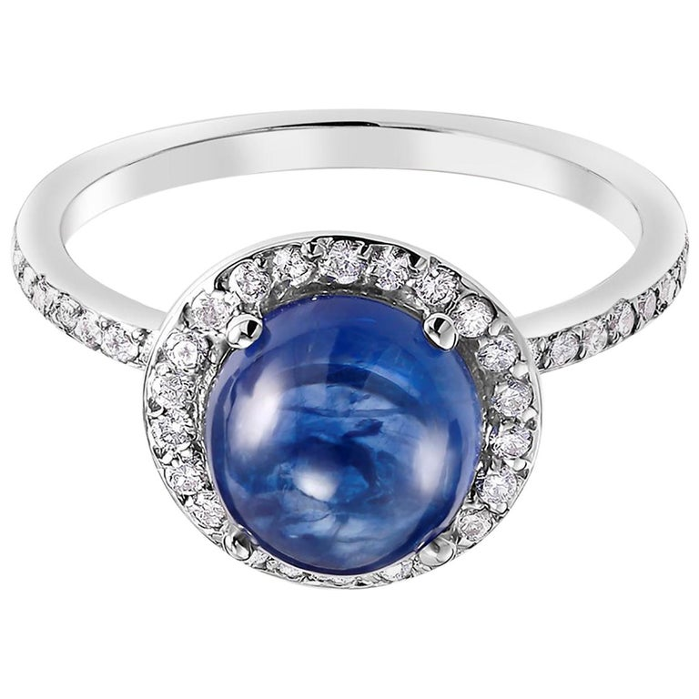 Eighteen karat white gold halo ring Ceylon cabochon sapphire weighing 3.60 carat      Round diamonds weighting 0.60 carat                                                                   Ring size 6 In Stock Ring can be resized  New Ring Handmade