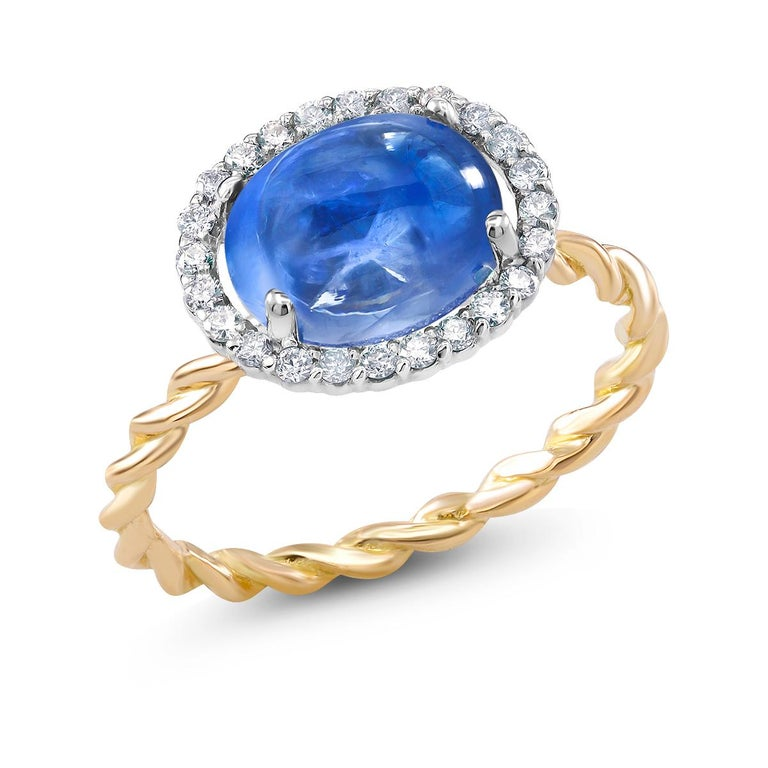 Fourteen karat rose and white gold braided ring Ceylon cabochon sapphire weighing  3.32 carat                                                                        Pave set diamond weighing 0.25 carat  Ring size 6 In Stock Ring can be resized  New