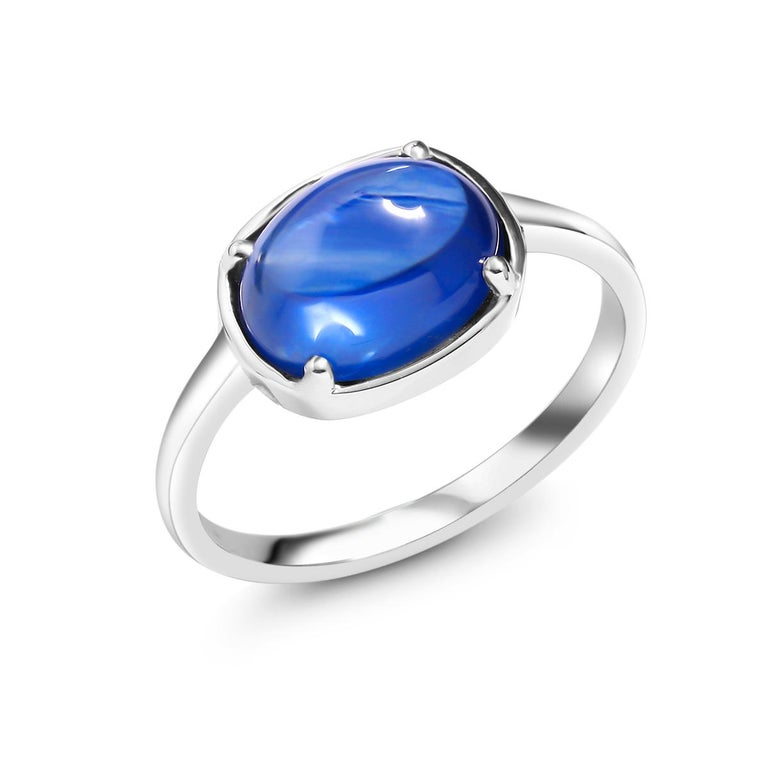Oval Cut Ceylon Cabochon Sapphire Weighing 4.25 Carat White Gold Cocktail Ring For Sale