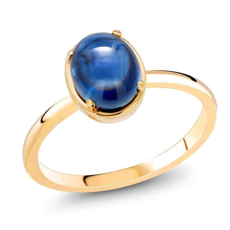 Oval Cut Ceylon Cabochon Sapphire Weighing 4.20 Carat Yellow Gold Cocktail Solitaire Ring For Sale